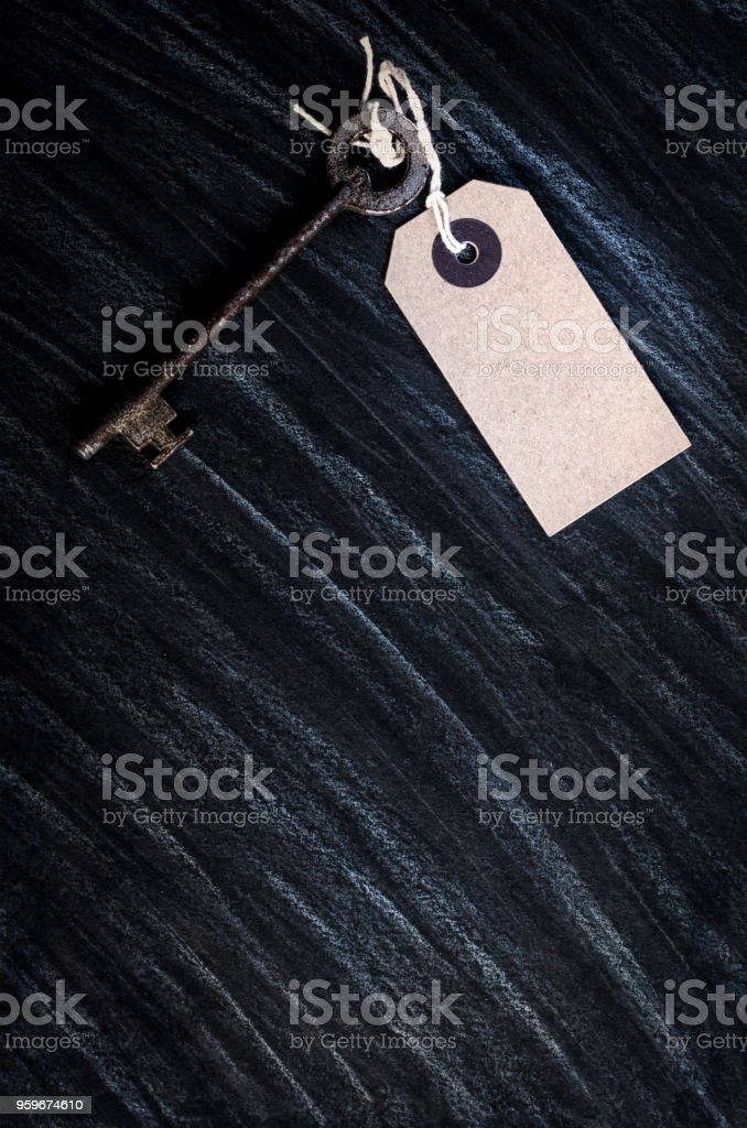 Old Key & A Blank Parcel Tag stock photo