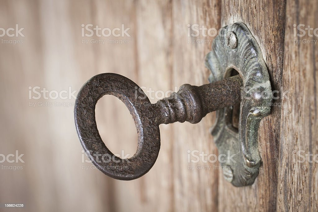 Old key in a keyhole stock photo