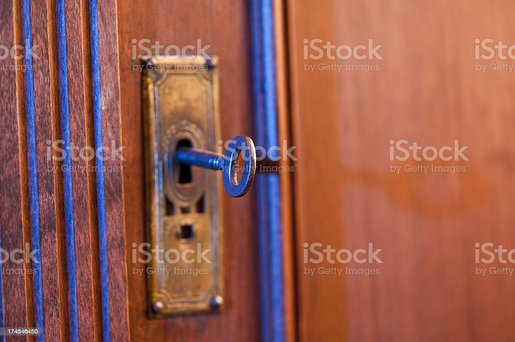 Old key in keyhole royalty-free stock photo