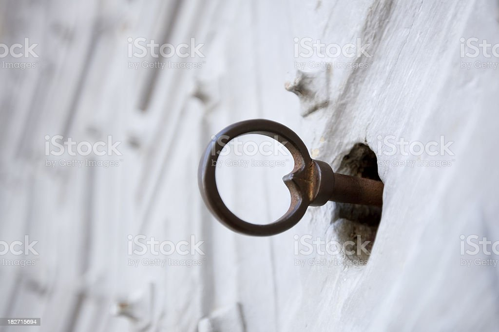 Old key in lock royalty-free stock photo