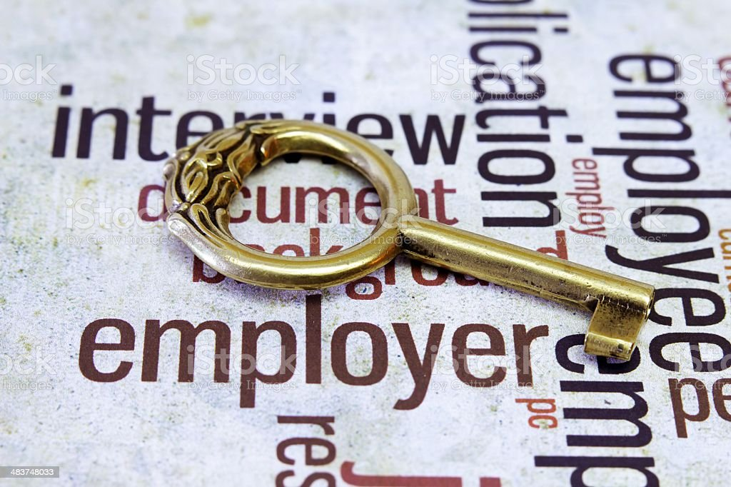 Old key on employer text royalty-free stock photo