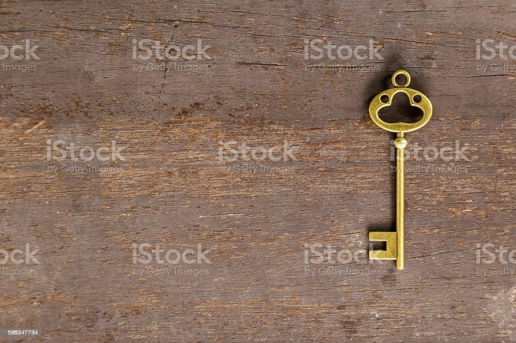 old key on wood background with space Lizenzfreies stock-foto