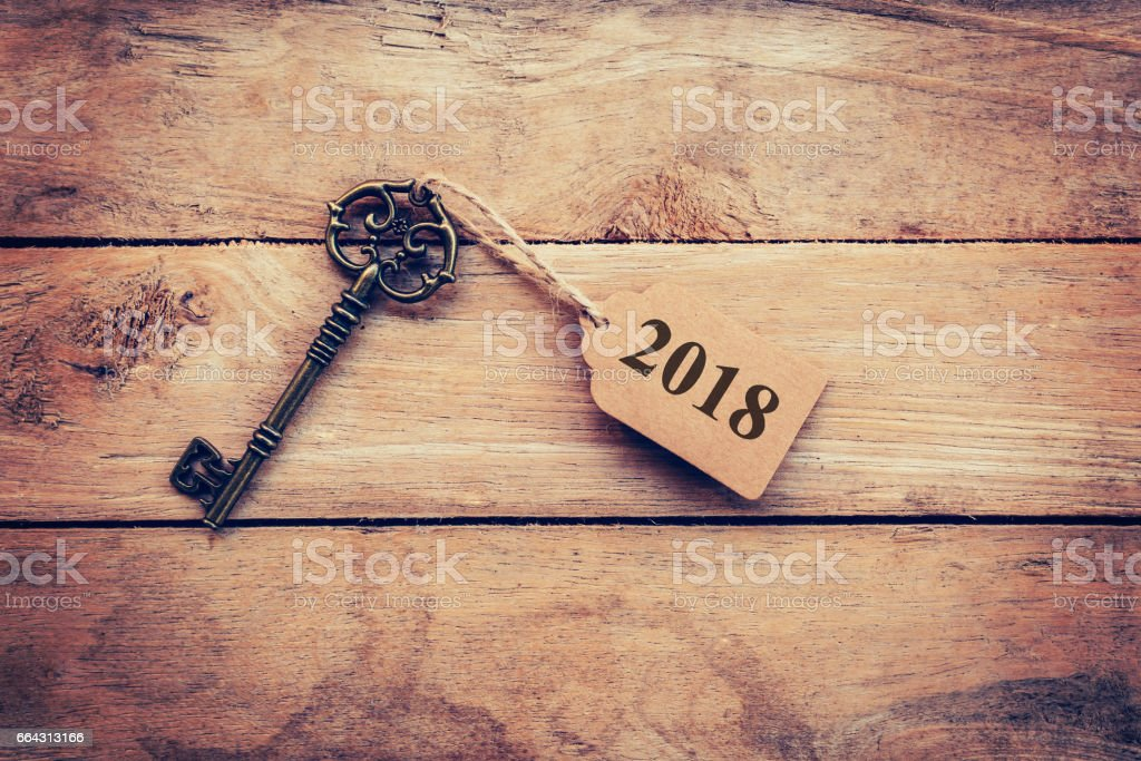 Old key vintage on wood with tag 2018. stock photo