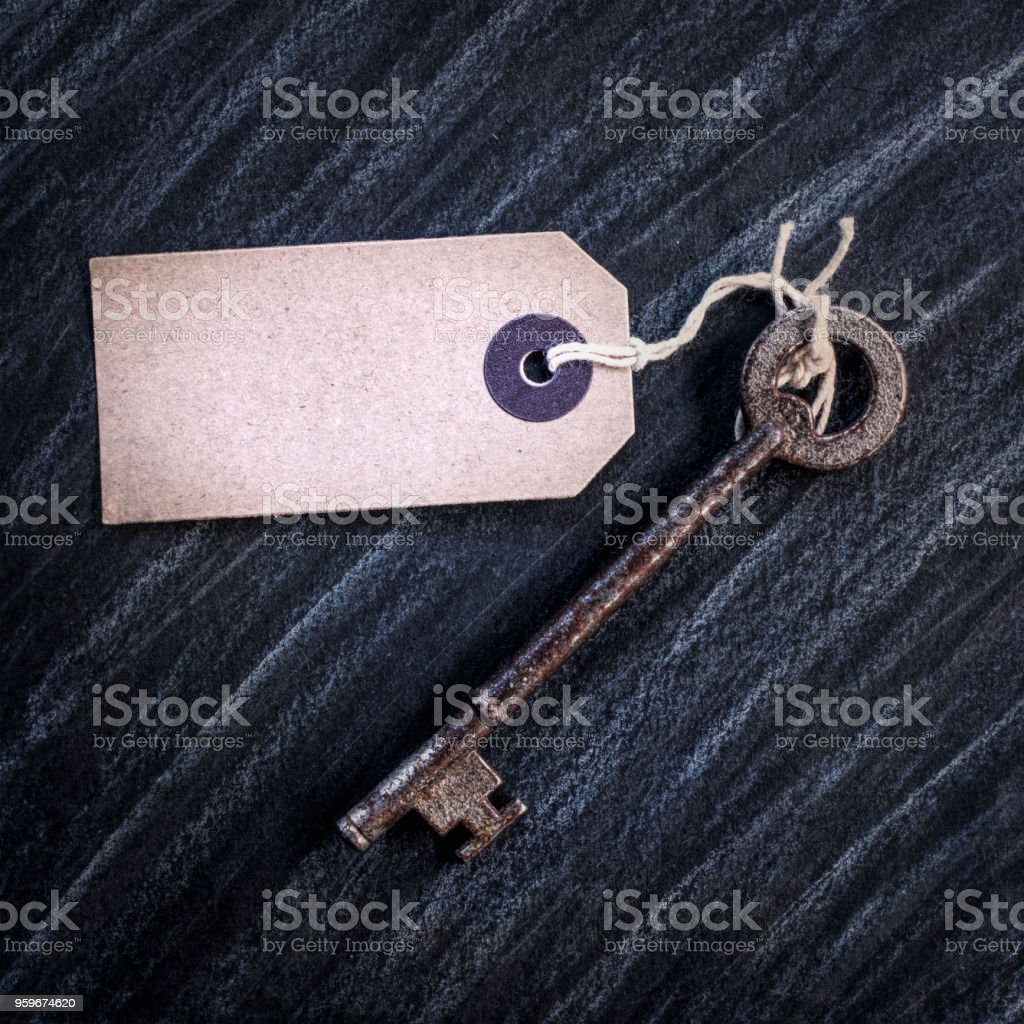 Old Key with a blank label stock photo