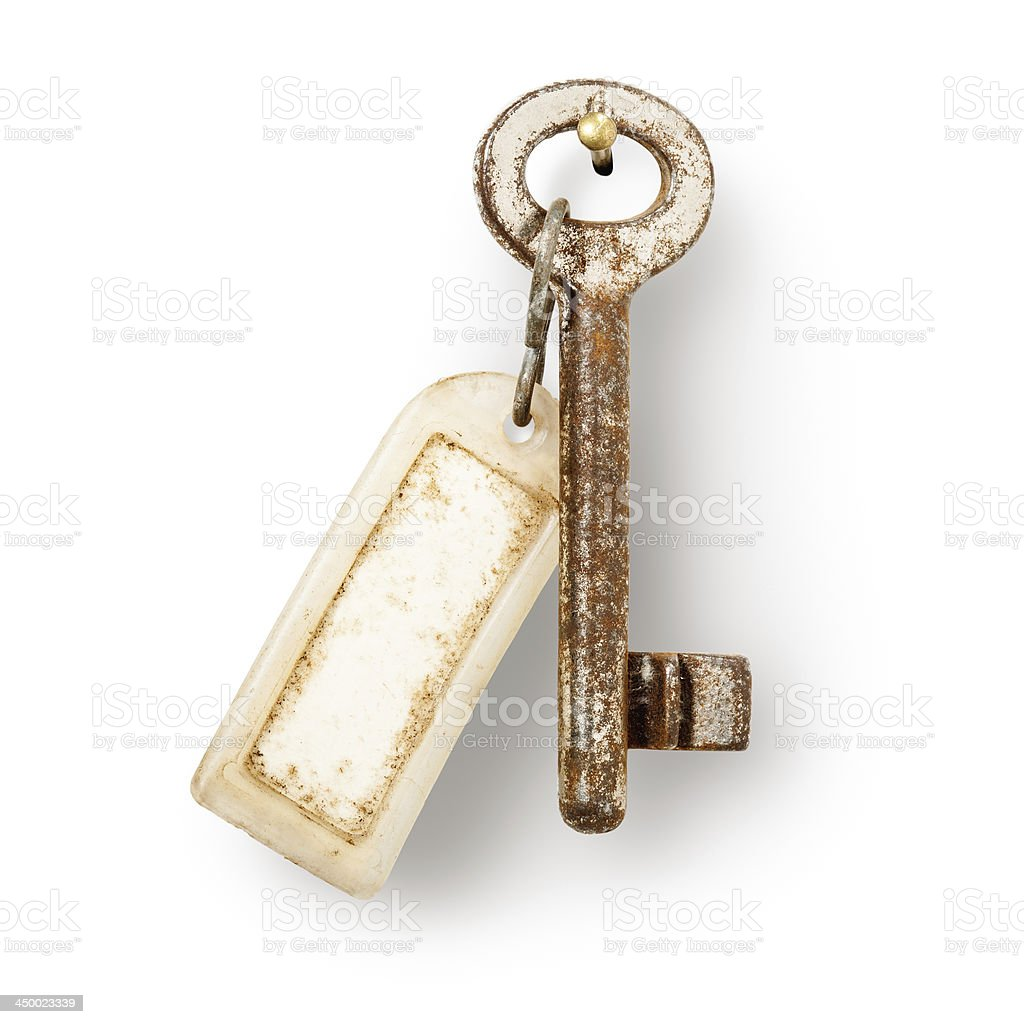 Old key with label stock photo