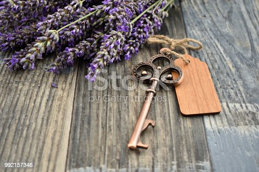 istock Old key with lavender stock images 992157346