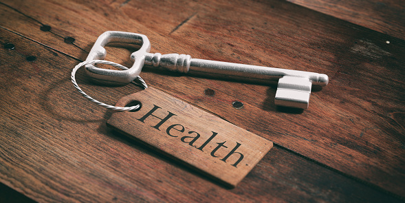 istock Old key with tag health on a wooden background. 3d illustration 1017718924