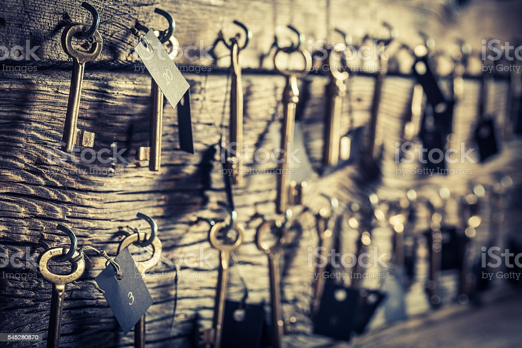Old keys for hotel rooms stock photo