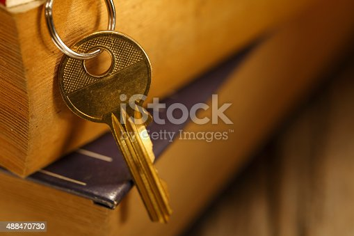 184640907istockphoto old keys on a old book 488470730