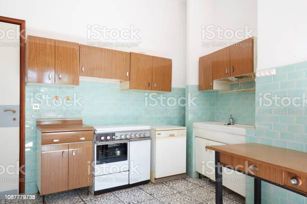 Old kitchen interior with turquoise tiles in old house picture id1087779738?b=1&k=6&m=1087779738&s=612x612&h=ankicfhzi5rm z6rbqtztgpo60ntvjyfz8qqp3x4isq=