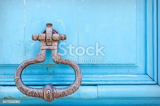 Royal style doorknocker on blue door, Paris, France