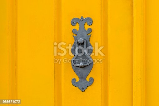 Old knockers on colored doors
