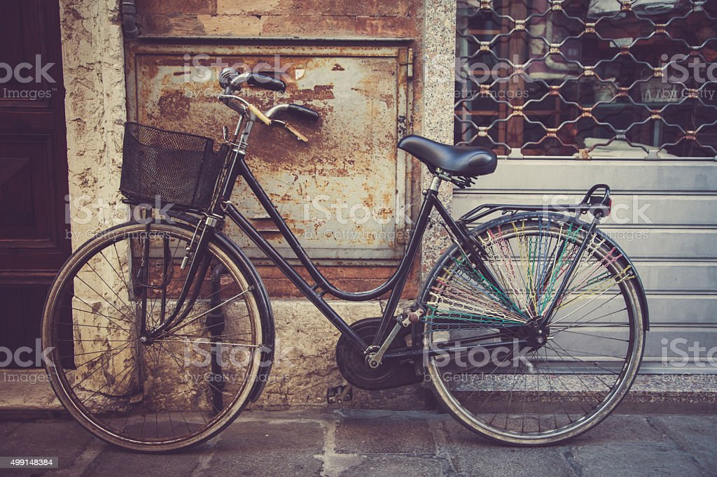 old ladies bike in a street stock photo