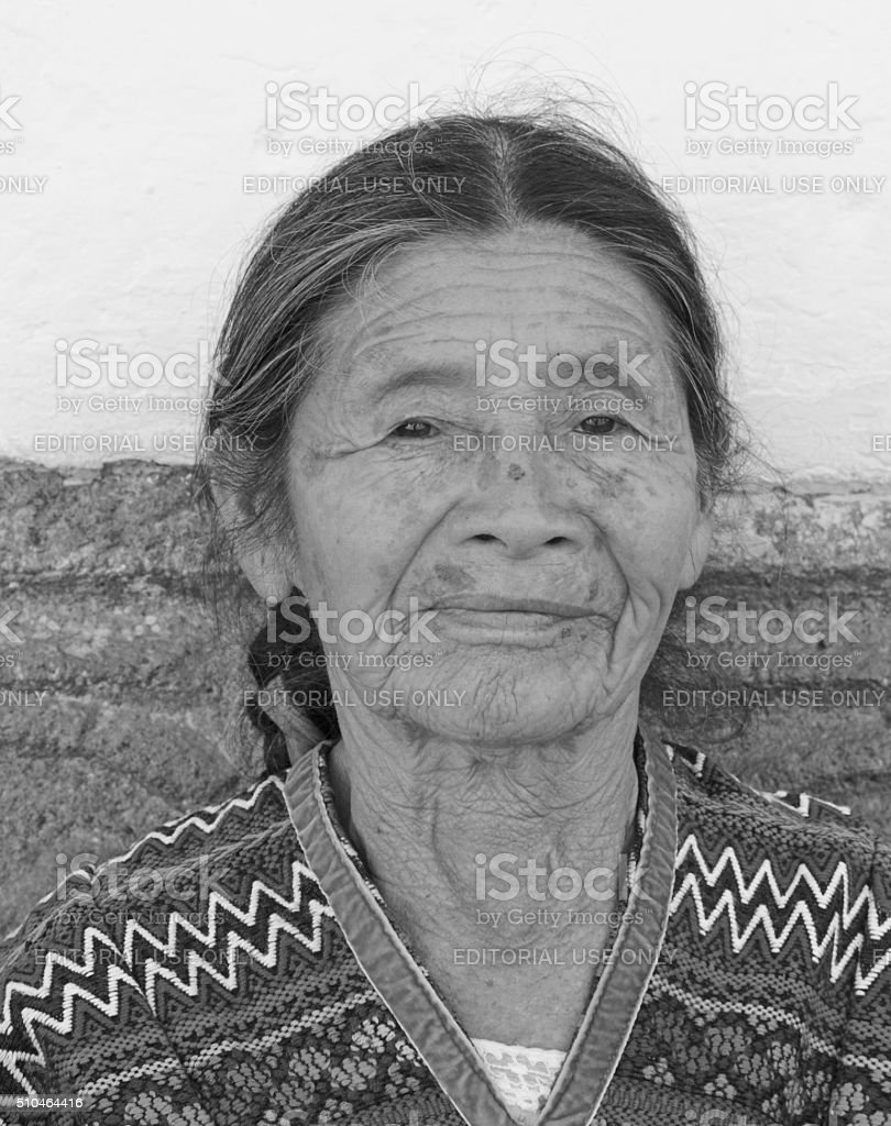 Old lady by the wall stock photo