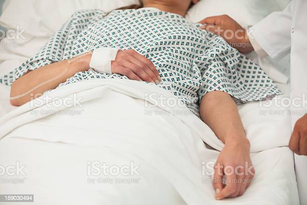 Old Lady Lying Sick In Bed Stock Photo - Download Image Now