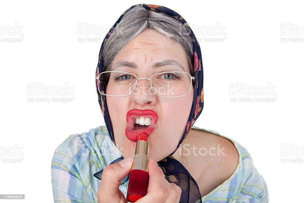 Old Lady Putting Lipstick On royalty-free stock photo