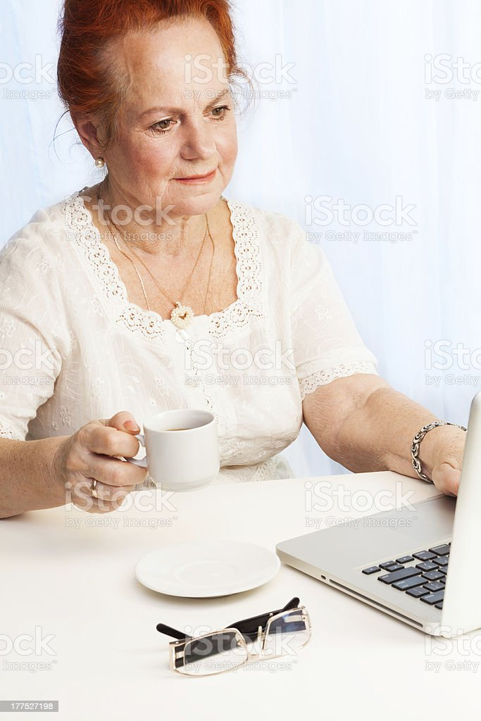 Old lady reading her email royalty-free stock photo