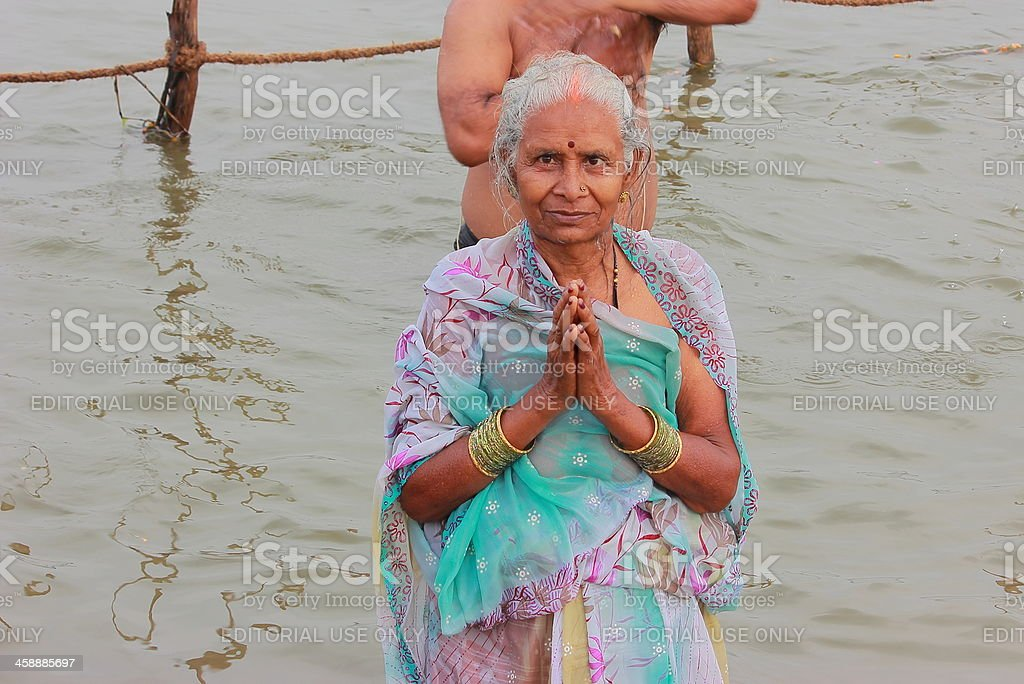 Old lady taking holy dip in Kumbh 2013 royalty-free stock photo
