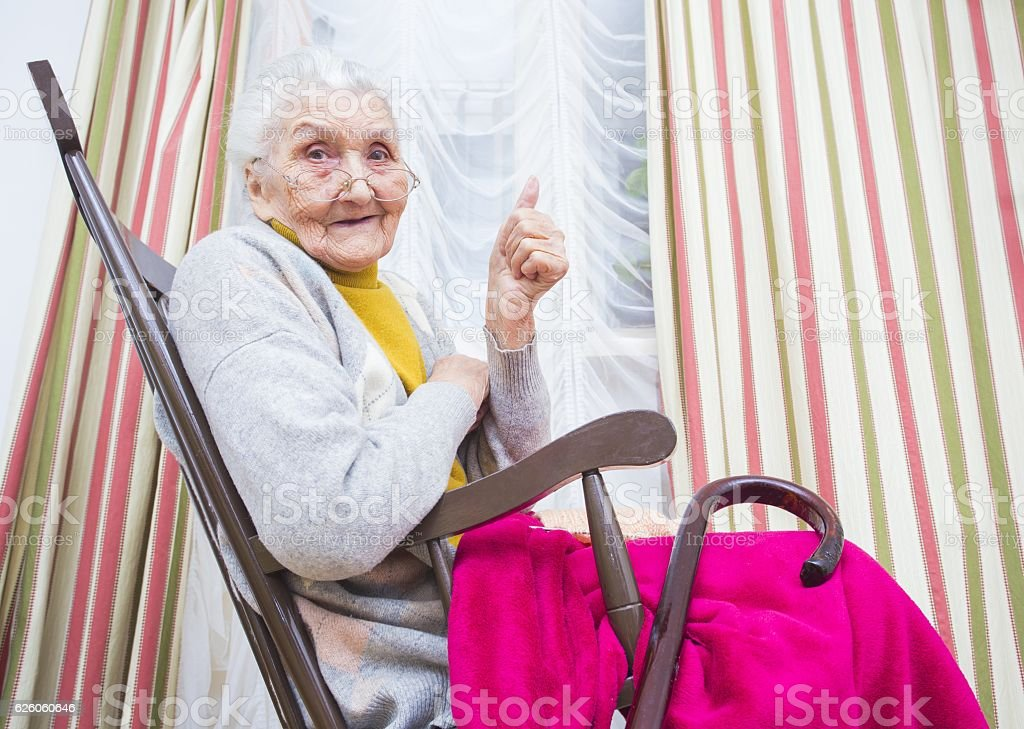 Old lady thumbs up stock photo