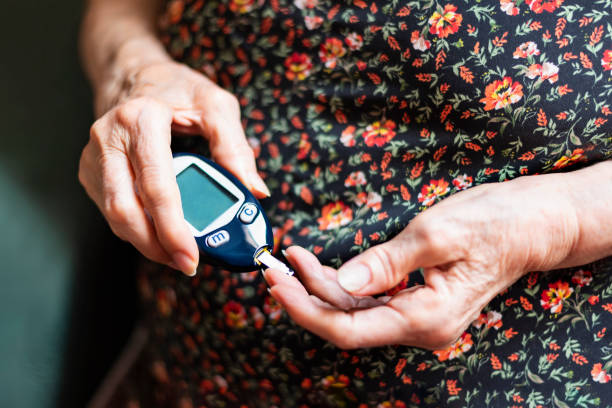 old lady tracking her glucose levels. health concept - diabetic stock photos and pictures