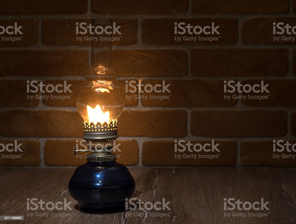 Old lamp illuminates darkness of the night. stock photo