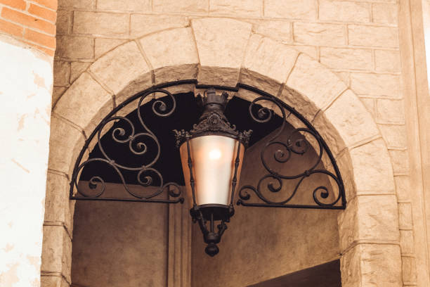 Old lamp in a passageway with decoration stock photo