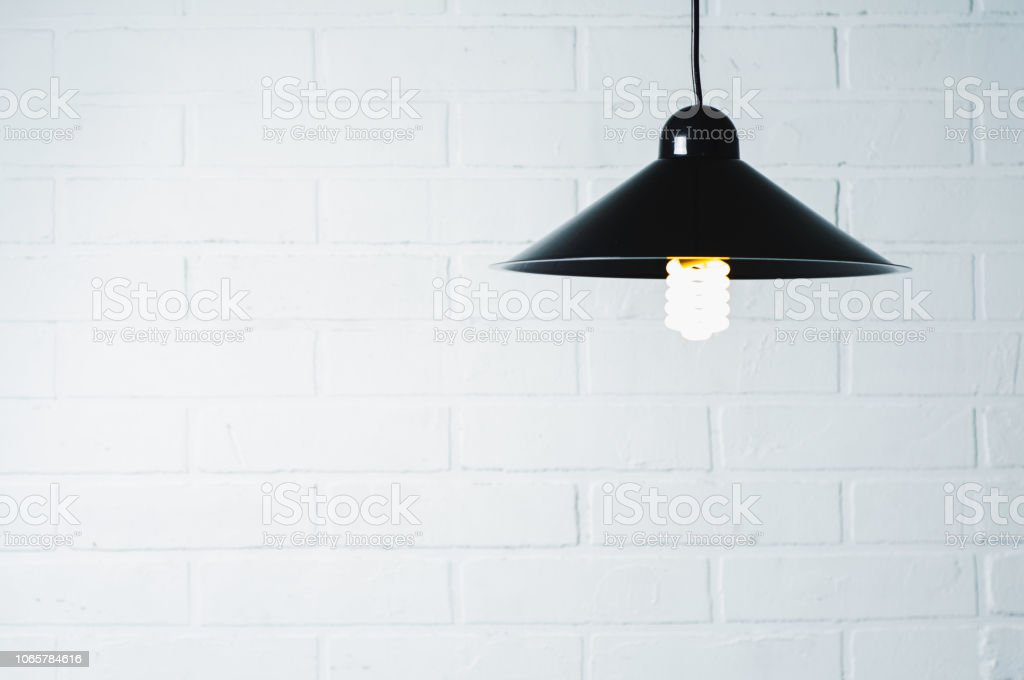 Old lamp in front of a white wall stock photo