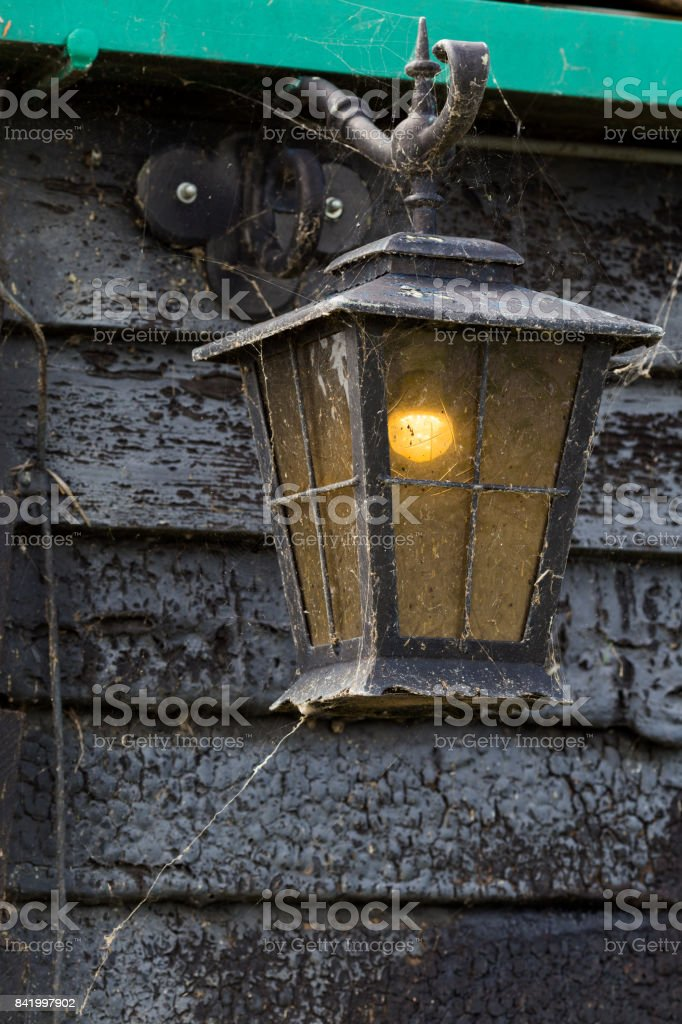 Old lamp with lighting bulb inside stock photo