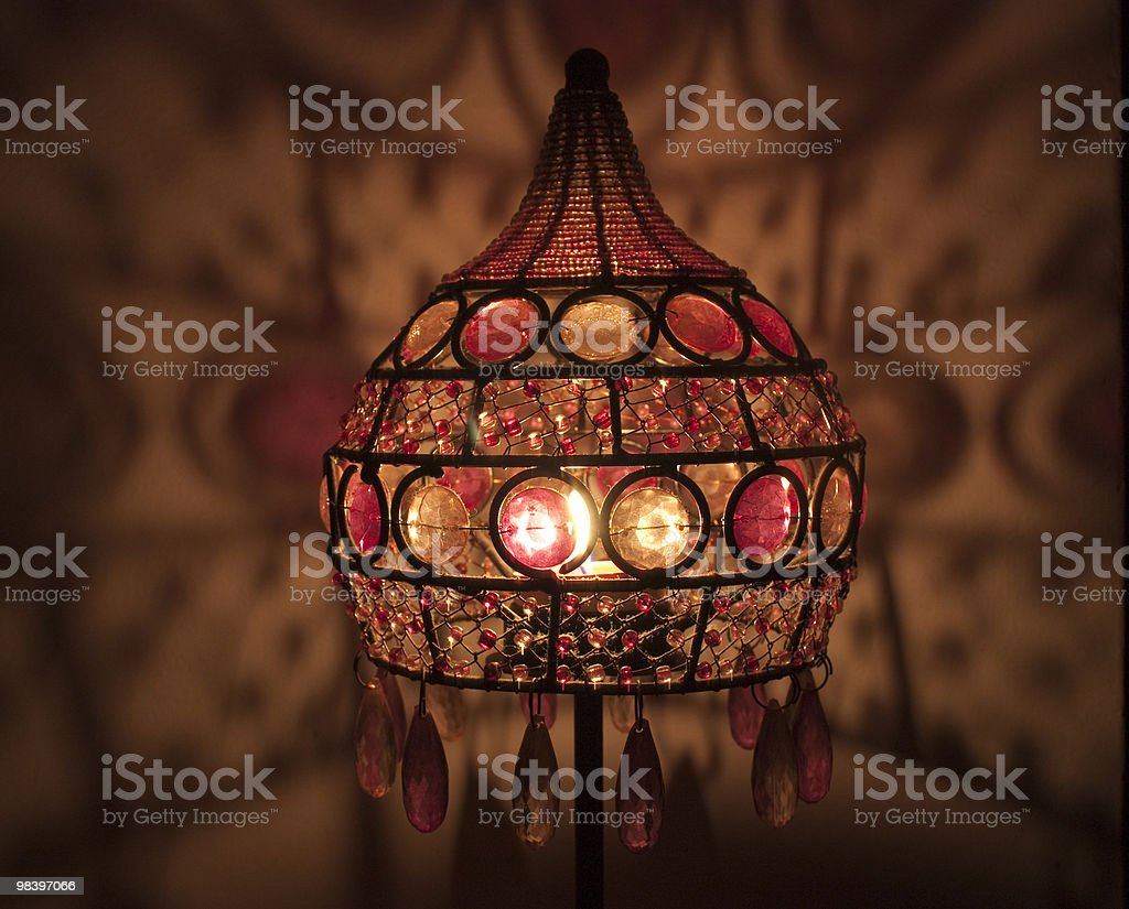 Old lamps, and colored glass candle royalty-free stock photo