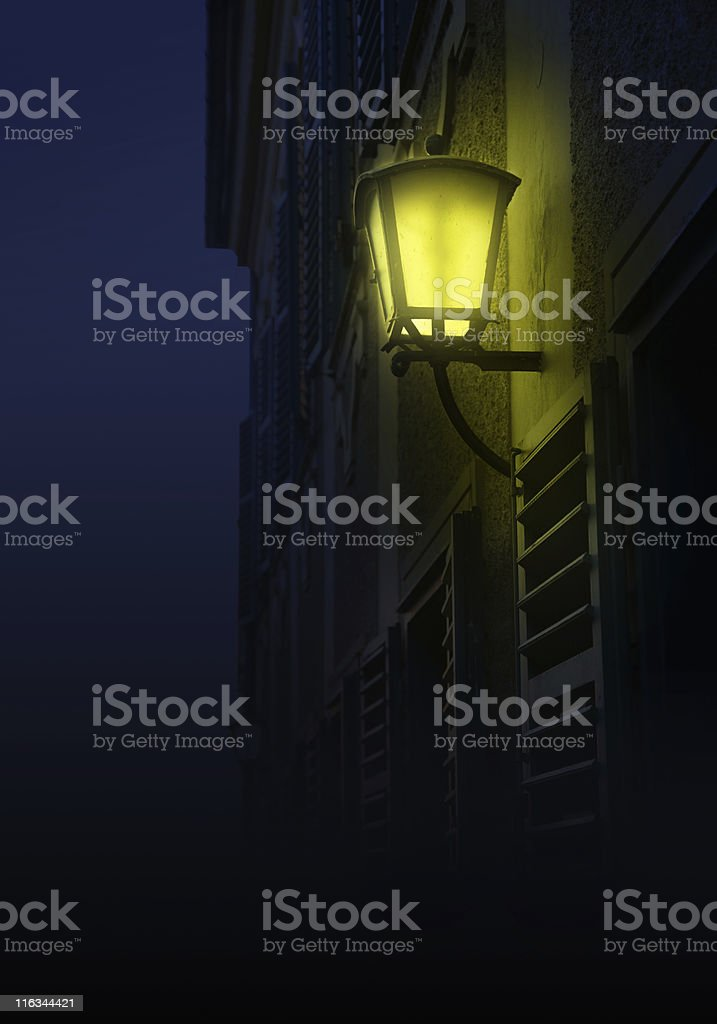 old lantern in the night stock photo