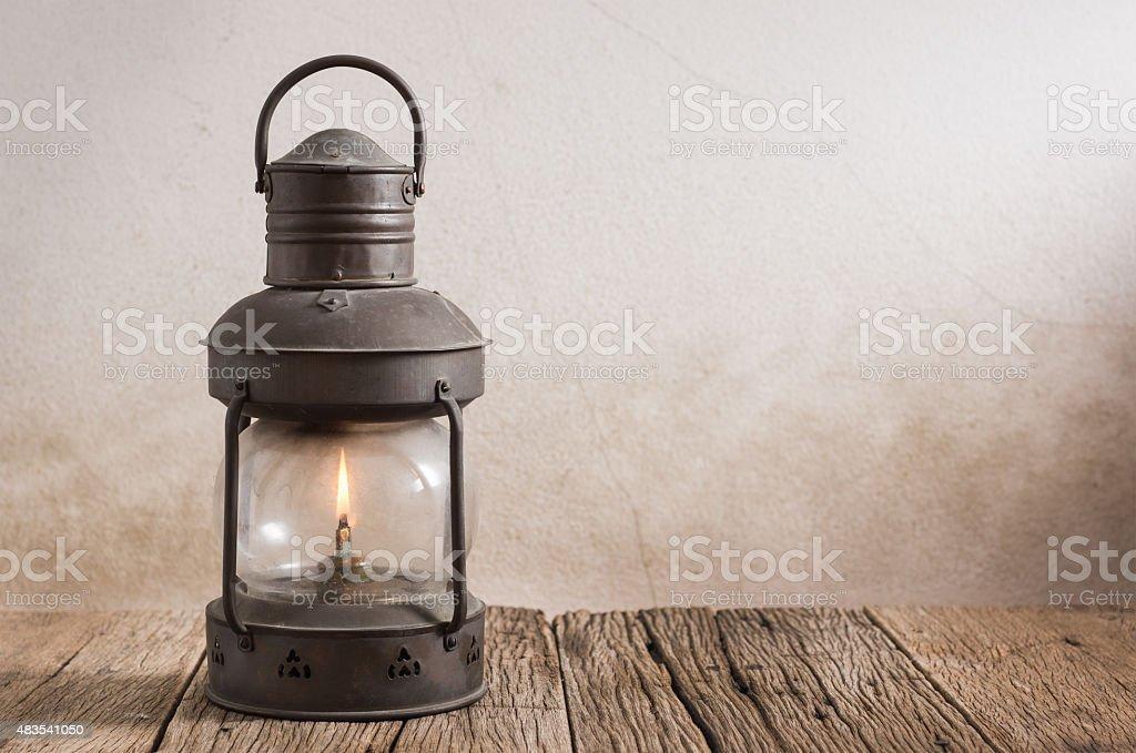 old lantern on wood stock photo