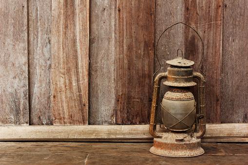 Old lantern on wooden background