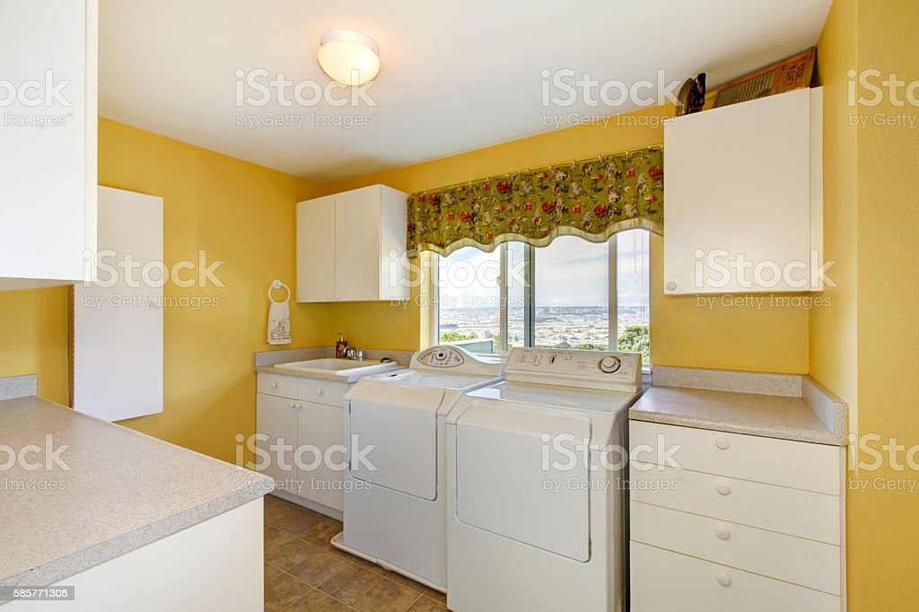 Old Laundry Room With White Cabinets And Yellow Walls Stock Photo ...
