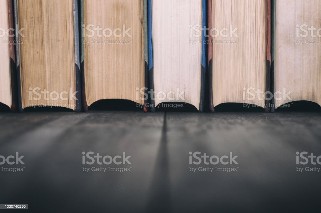 Old Law books on the black wooden background, black wooden backdrop.