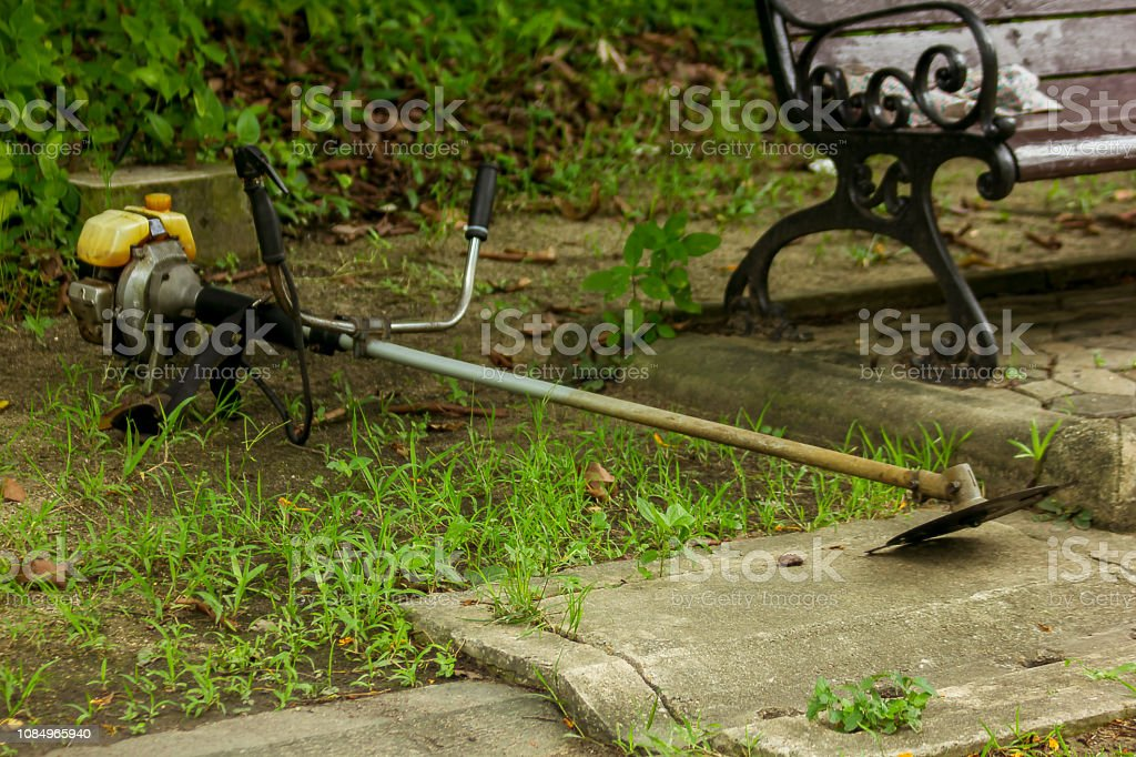 Old lawn mower lying on the floor. stock photo