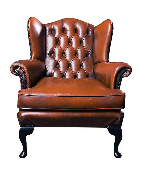 old leather armchair on a white background The old leather armchair on a white background. Saved clipping path. armchair stock pictures, royalty-free photos & images