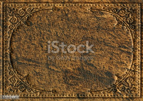 istock Old leather bookcover with engraved scroll pattern 172124912