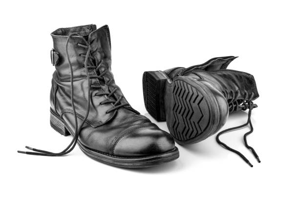 Old leather boots on white background stock photo
