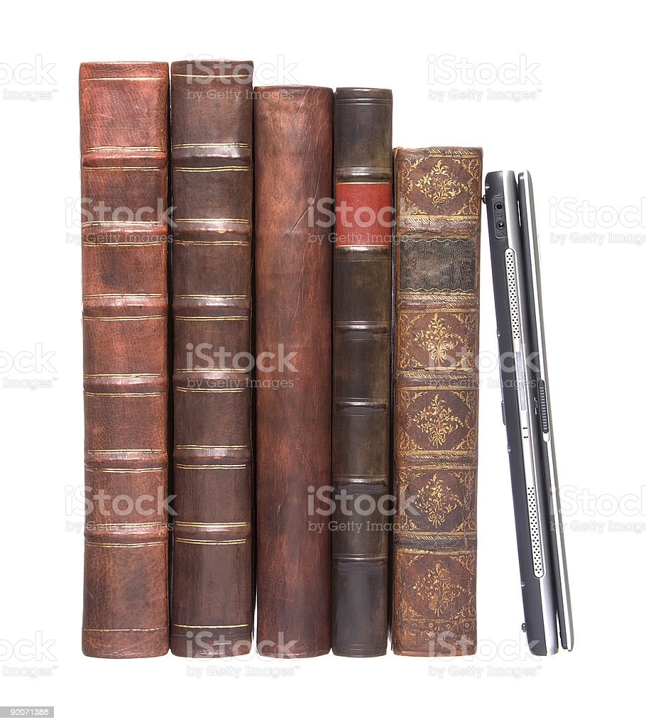 Old leather bound books with a laptop royalty-free stock photo