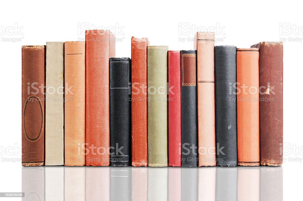 Old leather covered books isolated on white background stock photo