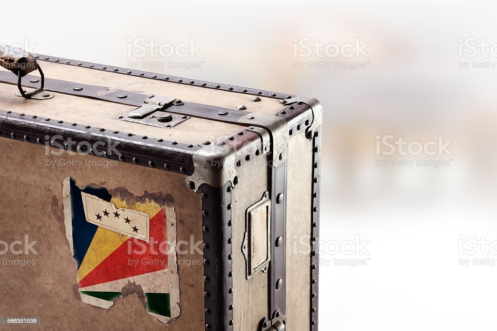 Old leather suitcase with flag of Seychelles stock photo