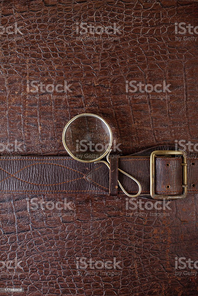 Old leather texture with magnifying glass royalty-free stock photo