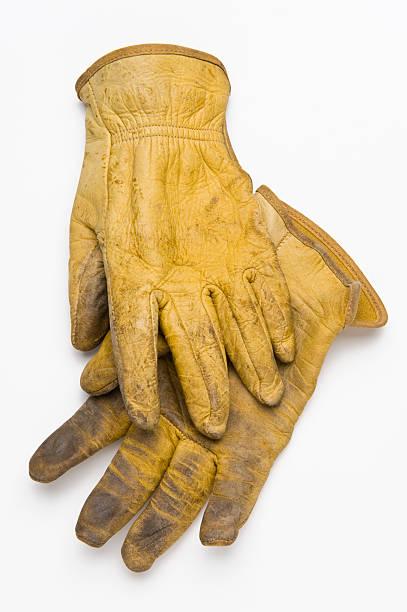 alte arbeit handschuhe aus leder - arbeitshandschuhe stock-fotos und bilder