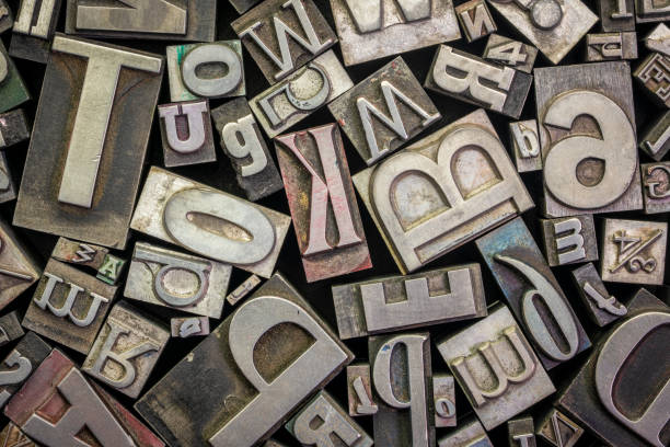 old letterpress metal type printing blocks - typescript stock pictures, royalty-free photos & images