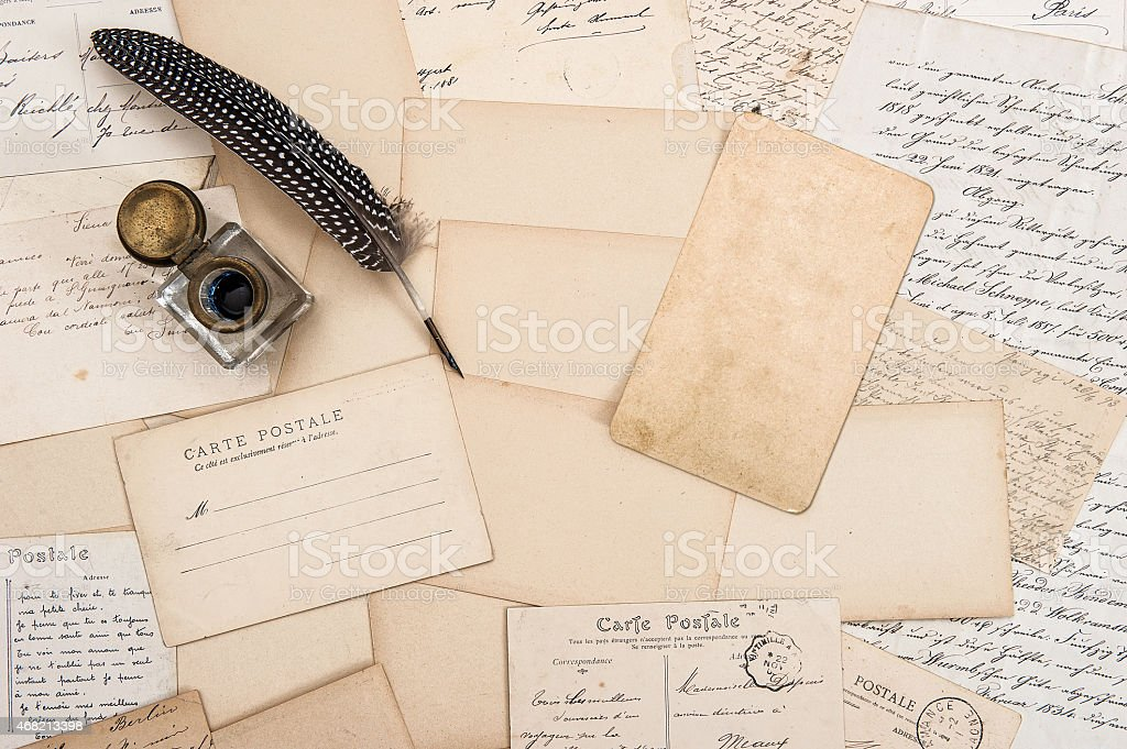 Old letters, vintage postcards and antique feather pen. Mock up stock photo