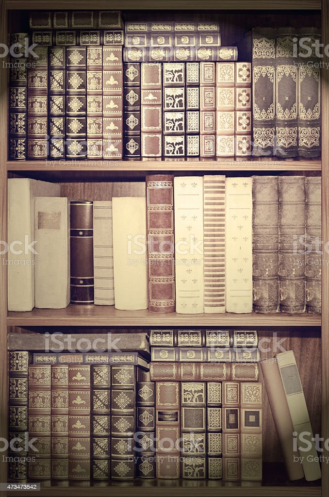 Old library, cover books on shelves.