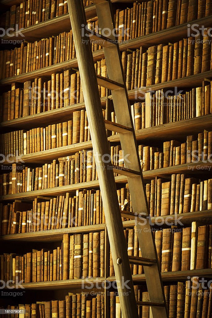 old library with books and ladder royalty-free stock photo