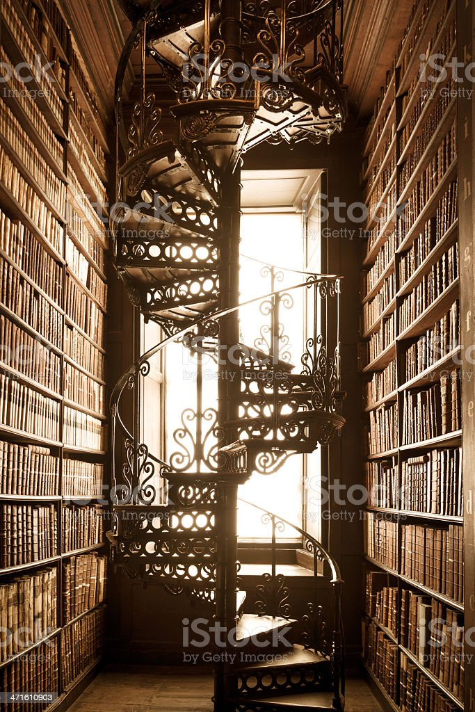old library with books and staircase