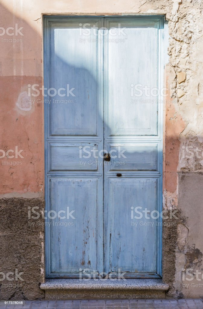 Old light blue wooden door stock photo