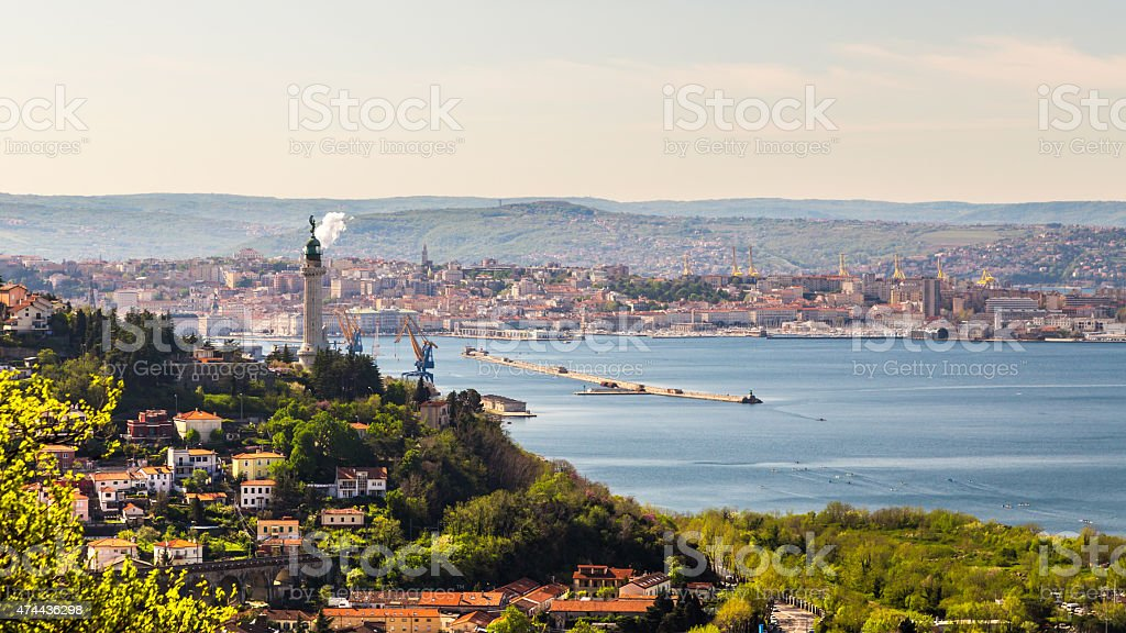 Old lighthouse in the bay of Trieste stock photo